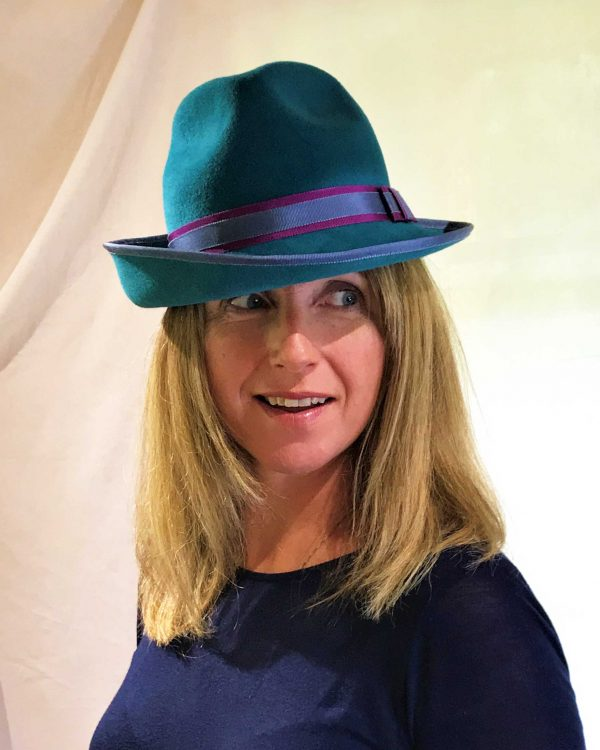 Turquoise hat worn by model