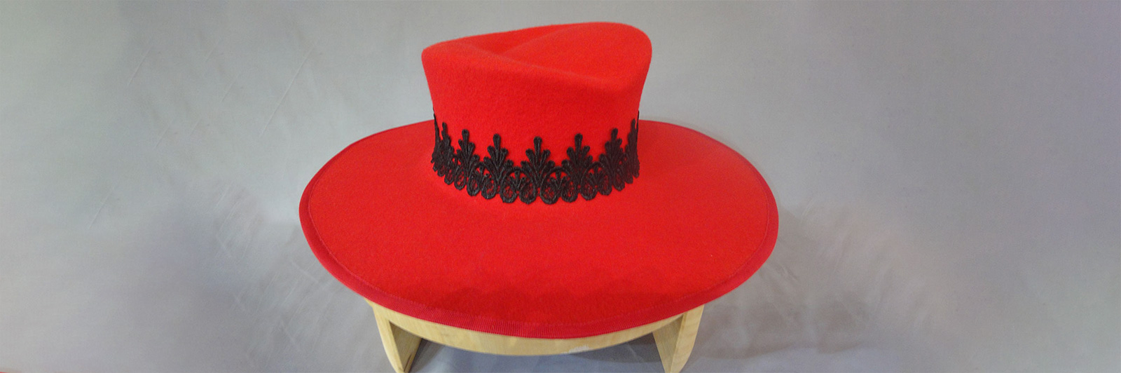 red felt hat with black lace detail